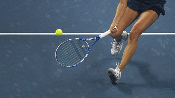 Radwanska of Poland hits a return to Petkovic of Germany during their women's final match at the China Open tennis tournament in Beijing